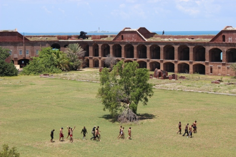 The men are escorted through historic Fort Jefferson to receive initial care and rest. Photo Source: Matthew Toro. August 4, 2015.