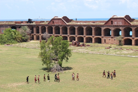 The men are escorted into historic Fort Jefferson to receive initial care and rest. Photo Source: Matthew Toro. August 4, 2015.