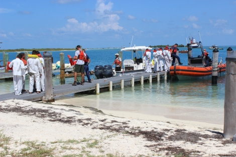 A few hours after arriving at Dry Tortugas, the men are escorted out of the national park by the US Coast Guard. Photo Source: Matthew Toro. August 4, 2015.