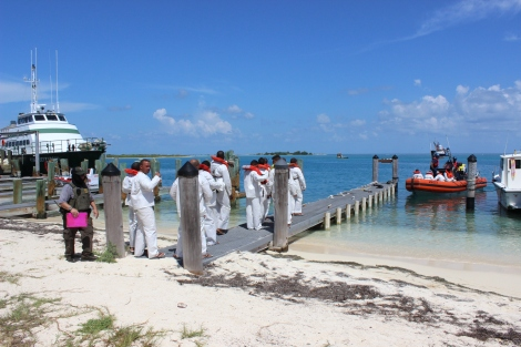 A few hours after arriving at Dry Tortugas, the men are escorted out of Dry Tortugas National Park by the US Coast Guard. Photo Source: Matthew Toro. August 4, 2015.
