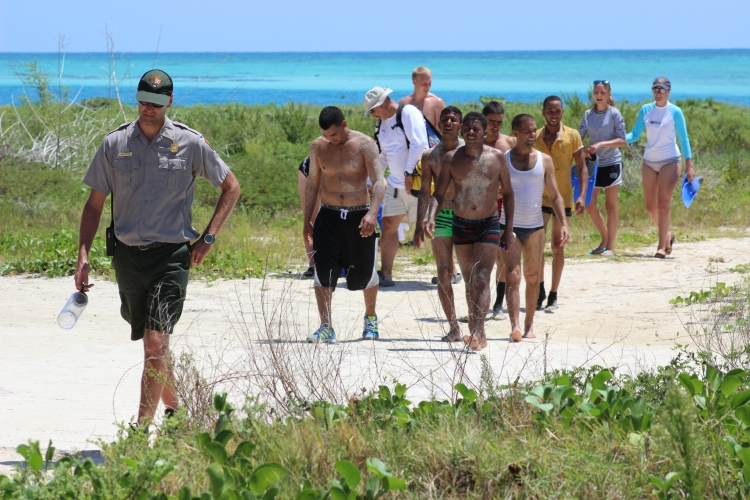 A Dry Tortugas National Park ranger leads the new arrivals to shelter and safety. Photo Source: Matthew Toro. August 4, 2015.